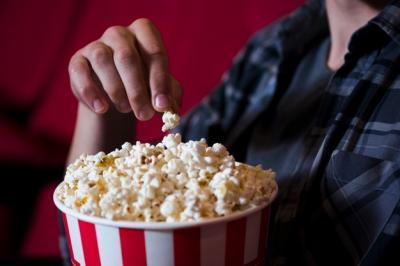 man-eating-popcorn-in-cinema_23-2148202098.jpg